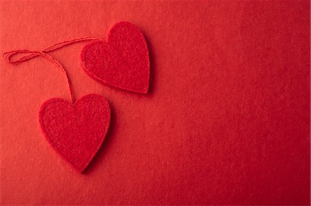 Heart ornaments on red background Stock Photo - Premium Royalty-Free, Code: 632-05991510