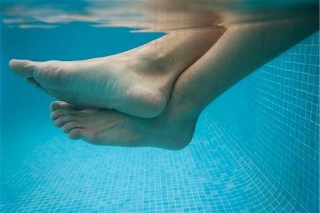 swimming pool water - Man's legs in water, underwater view Stock Photo - Premium Royalty-Free, Code: 632-05991578