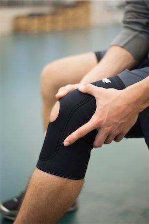 Man wearing knee brace, cropped Stock Photo - Premium Royalty-Free, Code: 632-05991585