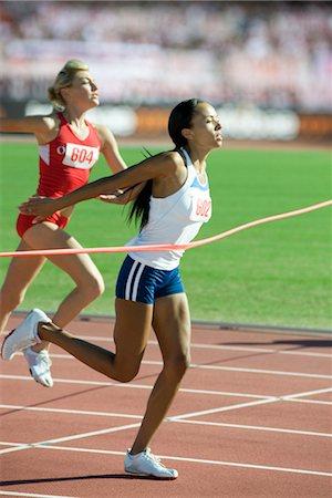 finish line - Female runner crossing finish line Stock Photo - Premium Royalty-Free, Code: 632-05991671