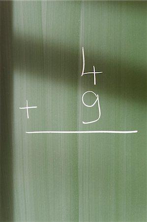 Math problem on blackboard Stock Photo - Premium Royalty-Free, Code: 632-05991690
