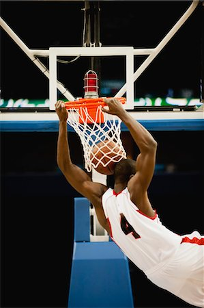 scoring - Basketball slam dunking, rear view Stock Photo - Premium Royalty-Free, Code: 632-05991709