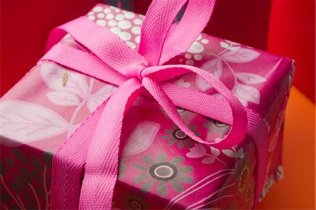 present wrapped close up - Festively wrapped gift Stock Photo - Premium Royalty-Free, Code: 632-05991762