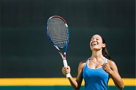 Young female tennis player cheering, portrait Stock Photo - Premium Royalty-Free, Code: 632-05991843
