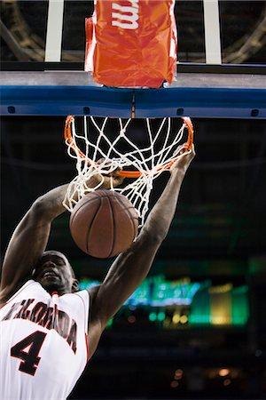 Basketball player slam dunking basketball Stock Photo - Premium Royalty-Free, Code: 632-05991959