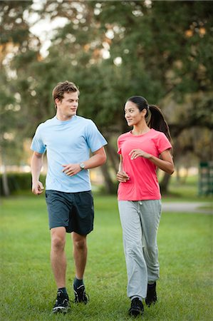 Young couple jogging on grass Stock Photo - Premium Royalty-Free, Code: 632-05991952