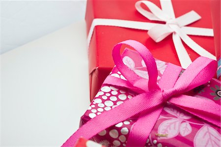 present wrapped close up - Festively wrapped gifts Stock Photo - Premium Royalty-Free, Code: 632-05991966