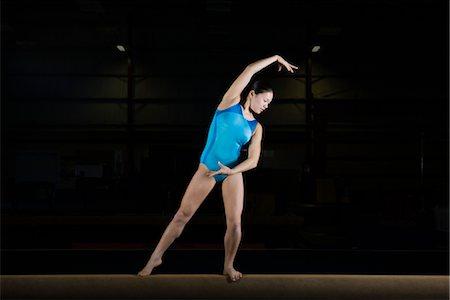 Teenage girl gymnast on balance beam Stock Photo - Premium Royalty-Free, Code: 632-05992009