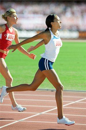 finish line - Female runner crossing finish line in race Stock Photo - Premium Royalty-Free, Code: 632-05992023