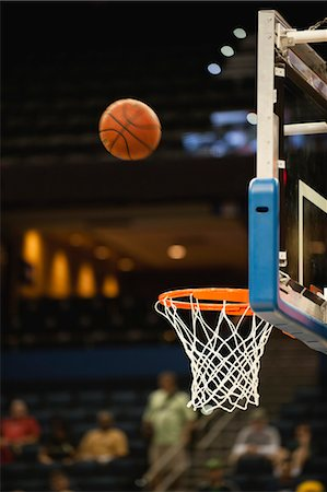 Basketball in midair above basketball hoop Stock Photo - Premium Royalty-Free, Code: 632-05992101