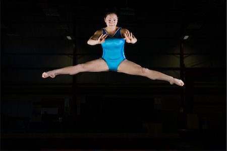 Teenage girl gymnast performing split leap Stock Photo - Premium Royalty-Free, Code: 632-05992102