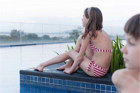 preteen girl swimsuit - Girl in bikini sitting by poolside Stock Photo - Premium Royalty-Free, Code: 632-06029360