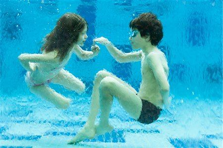 preteen swim - Brother and sister playing underwater in swimming pool Stock Photo - Premium Royalty-Free, Code: 632-06029363