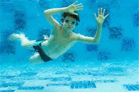 preteen swim - Boy swimming underwater in swimming pool Stock Photo - Premium Royalty-Free, Code: 632-06029386