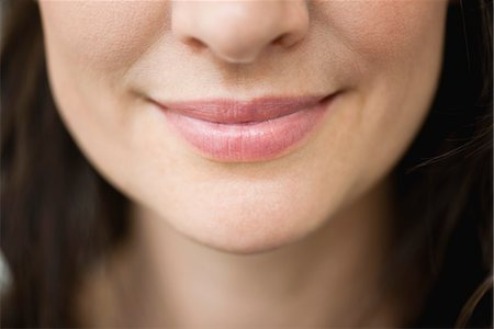 Close-up of woman's smiling lips Stock Photo - Premium Royalty-Free, Code: 632-06029418