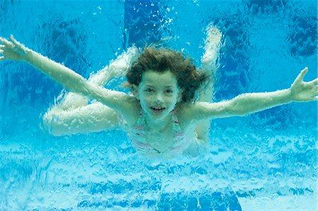 Girl swimming underwater in swimming pool Stock Photo - Premium Royalty-Free, Code: 632-06029445