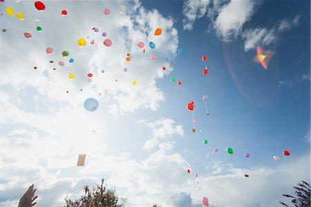 release - Balloons floating toward sky Stock Photo - Premium Royalty-Free, Code: 632-06029524