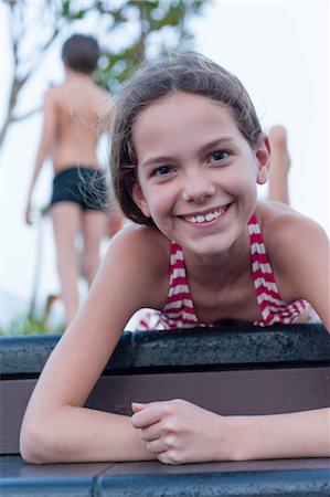Girl in bikini lying on stomach, portrait Stock Photo - Premium Royalty-Free, Code: 632-06029529