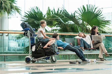 Family waiting in airport terminal Stock Photo - Premium Royalty-Free, Code: 632-06029699