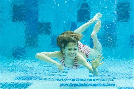 preteen girl swimsuit - Girl swimming underwater in swimming pool Stock Photo - Premium Royalty-Free, Code: 632-06029995