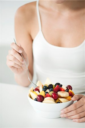 Woman with fruit bowl, mid section Stock Photo - Premium Royalty-Free, Code: 632-06030027