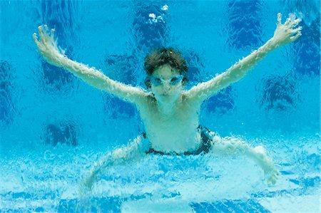 Boy swimming underwater in swimming pool Stock Photo - Premium Royalty-Free, Code: 632-06030110
