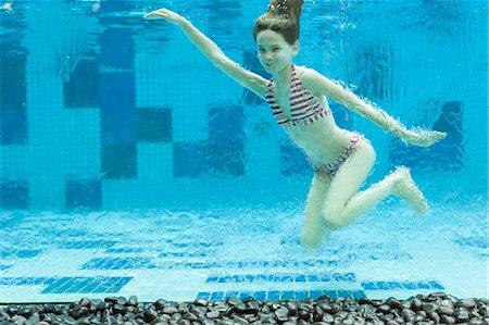 preteen girl swimsuit - Girl swimming underwater in swimming pool Stock Photo - Premium Royalty-Free, Code: 632-06030130