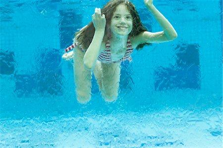 preteen bikini - Girl swimming underwater in swimming pool Stock Photo - Premium Royalty-Free, Code: 632-06030188