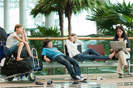 Family waiting in airport terminal Stock Photo - Premium Royalty-Free, Code: 632-06030238