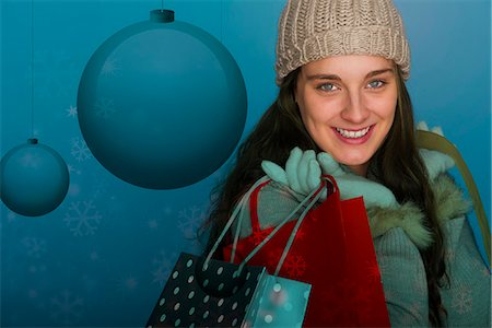 Young woman carrying Christmas shopping bags, portrait Stock Photo - Premium Royalty-Free, Code: 632-06118104