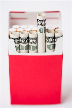 dece11 - Cigarette pack containing rolled dollars Stock Photo - Premium Royalty-Free, Code: 632-06118135