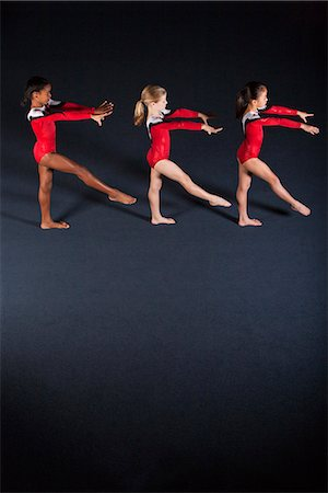 preteen girls gymnastics - Young girl gymnasts practicing Stock Photo - Premium Royalty-Free, Code: 632-06118188