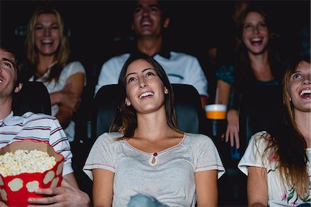 front row seat - Audience laughing in movie theater Stock Photo - Premium Royalty-Free, Code: 632-06118193
