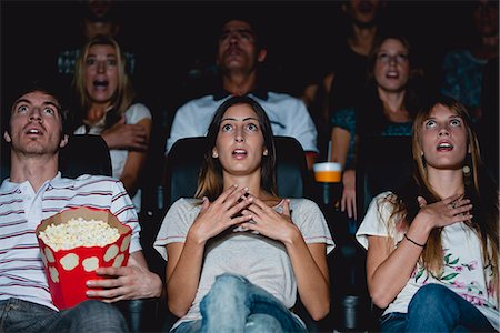 front row seat - Audience in movie theater with shocked expressions Stock Photo - Premium Royalty-Free, Code: 632-06118206