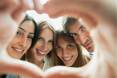 Friends making heart-shaped finger frame, portrait Stock Photo - Premium Royalty-Free, Code: 632-06118307