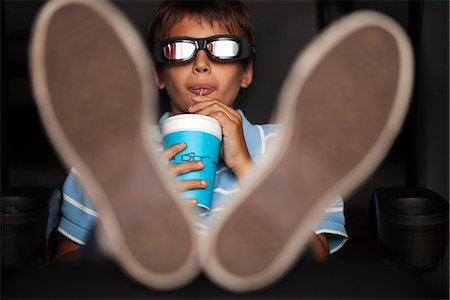 Boy enjoying 3-D movie in theater Stock Photo - Premium Royalty-Free, Code: 632-06118355