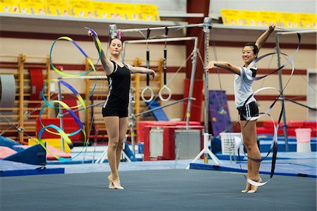 practise - Teenage girl gymnasts practicing rhythmic gymnastics, twirling ribbons Stock Photo - Premium Royalty-Free, Code: 632-06118425
