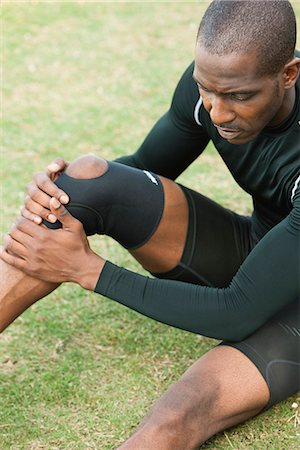 Male athlete wearing knee brace Stock Photo - Premium Royalty-Free, Code: 632-06118447