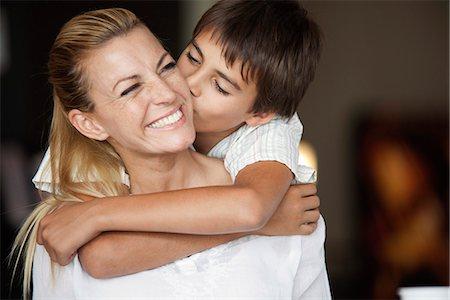 preteen kissing - Boy kissing mother's cheek Stock Photo - Premium Royalty-Free, Code: 632-06118489