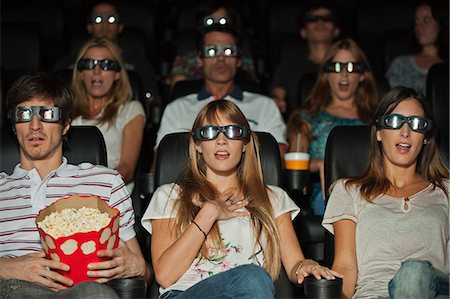 front row seat - Audience wearing 3-D glasses in movie theater Stock Photo - Premium Royalty-Free, Code: 632-06118503