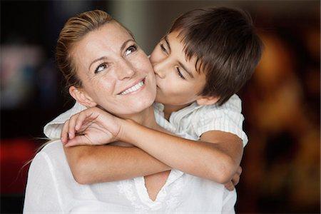 preteen kissing - Boy kissing his mother's cheek Stock Photo - Premium Royalty-Free, Code: 632-06118540