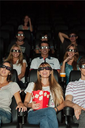 front row seat - Audience wearing 3-D glasses in movie theater Stock Photo - Premium Royalty-Free, Code: 632-06118578
