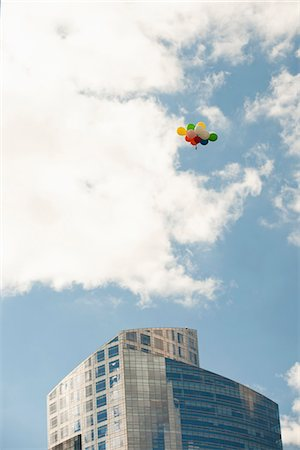 property release - Bunch of balloons flying over office building Stock Photo - Premium Royalty-Free, Code: 632-06118588