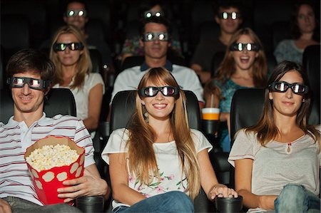 front row seat - Audience wearing 3-D glasses in movie theater Stock Photo - Premium Royalty-Free, Code: 632-06118629