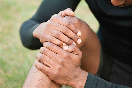 Man holding injured knee, cropped Stock Photo - Premium Royalty-Free, Code: 632-06118662