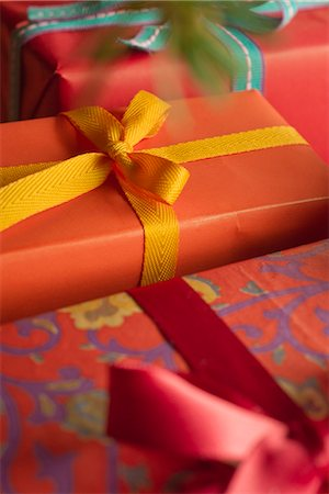 present wrapped close up - Festively wrapped Christmas gifts, close-up Stock Photo - Premium Royalty-Free, Code: 632-06118677