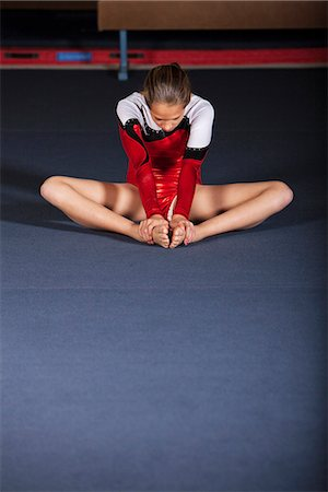 feet gymnast - Gymnast sitting on floor stretching Stock Photo - Premium Royalty-Free, Code: 632-06118701