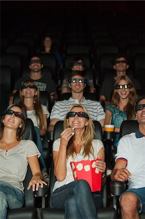 front row seat - Audience wearing 3-D glasses in movie theater Stock Photo - Premium Royalty-Free, Code: 632-06118794