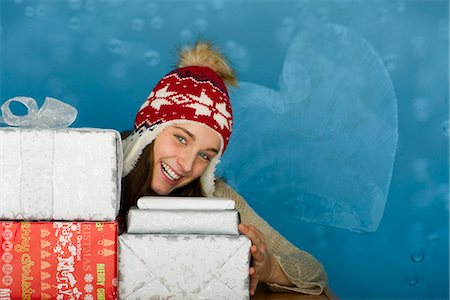 Young woman with stacks of Christmas gifts, portrait Stock Photo - Premium Royalty-Free, Code: 632-06118906