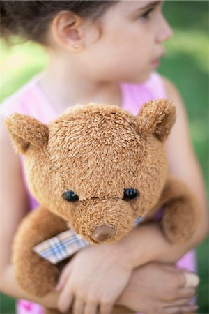 Girl embracing teddy bear Stock Photo - Premium Royalty-Free, Code: 632-06118929